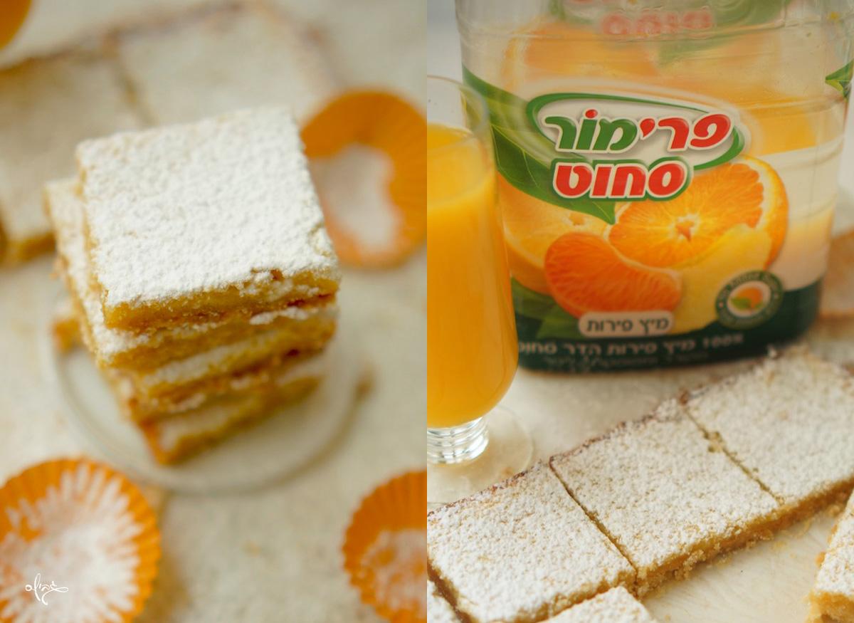ריבועי תפוז חלומיים, מיץ תפוזים של פרימור, כוס מיץ תפוזים ליד. וערימת ריבועי תפוז על צלחת לבנה קטנה.